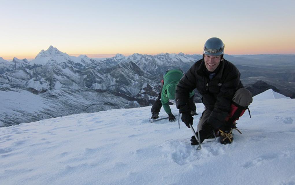 Carl Schmitt (front) and mountain guide Cesar Alvarado collect snow samples at the summit of Vallunaraju mountain in the Cordillera Blanca.