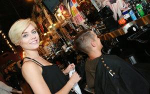 Floyd's 99 Barbershop employee, Janni Wilson, at work.