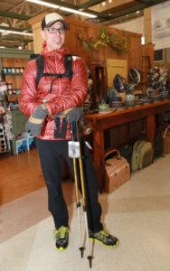 Jax Outdoor Gear employee, Mac Gaugh displays men's accessories.